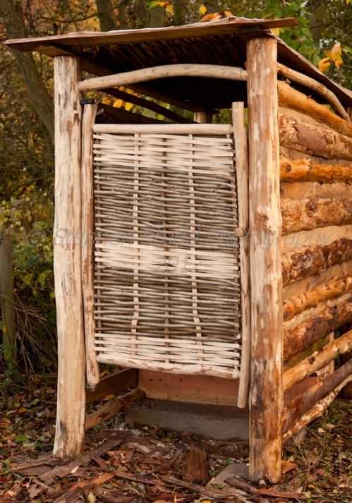 Compost toilet with woven hazel lath door and sweet chestnut frame; made by Dave Jackson at www.wildwoodcrafts.com
