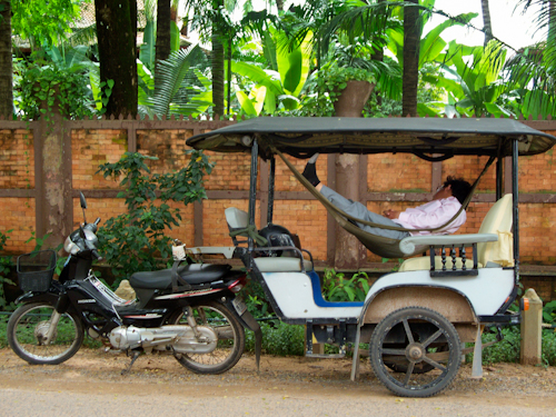 Man asleep in tuk tuk