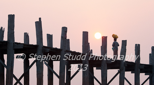 Myanmar (Burma) Mandalay U Bein bridge woman watching sunrise