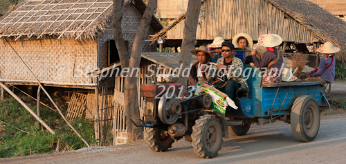 Myanmar (Burma) people on tractor