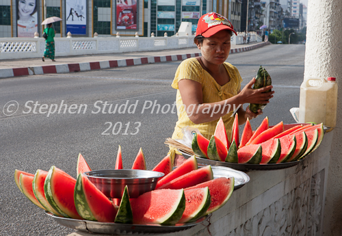 Myanmar (Burma)Yangon woman selling water melon at street side