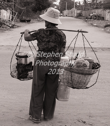 Woman carrying baskets in Siem Reap, Cambodia