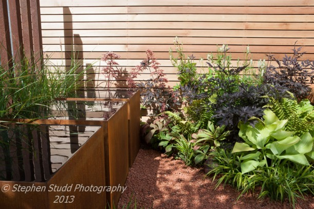 Tatton Park RHS Flower Show 2013 winner of the RHS National Young Designer of the Year award 2013 and Gold Medal Escape to the City Designed by  Tony WoodsBuilt by Garden Club London