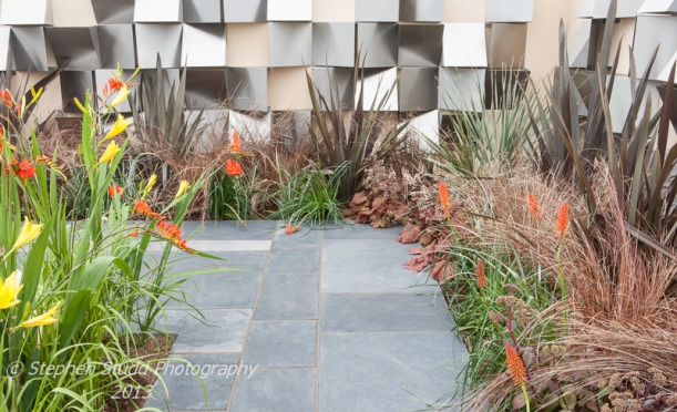 Tatton Park RHS Flower Show 2013 A Stainless Century Designed by Phil HirstSponsored by Sanctuary Group Built by Garden Style Awarded Gold Medal and Best Large Garden