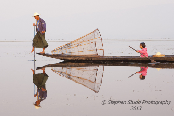 Inle lake, Myanmar (Burma) fisherman with girl on boat