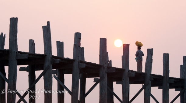 Myanmar Mandalay U Bein bridge woman watching sunrise