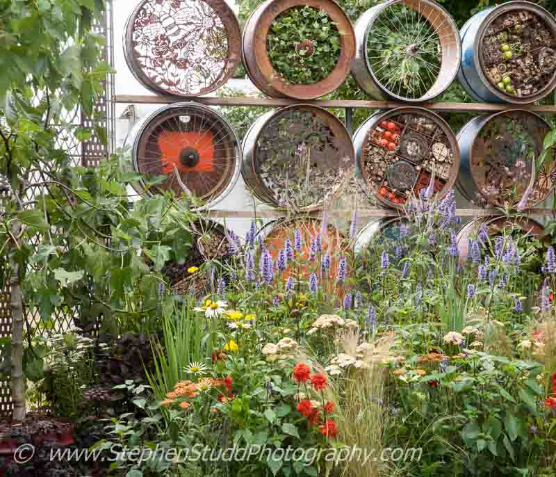 Hampton Court Flower Show 2014, Stephen Studd photography- Garden - Space to Connect and Grow - view of garden - Designer - Jeni Cairns in collaboration with Sophie Antonelli - Sponsor - Metal - Earls Scaffolding & British Sugar