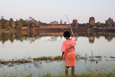 digital travel and landscape photography holidays, vacations, tours and workshops to Asia, Cambodia: Angkor Wat, Vietnam, Burma (Myanmar), Marrakech Marrakesh Morocco, the Gower Wales UK South East Asia Cambodia Siem Reap Angkor Wat temple complex UNESCO World Heritage site young boy fishing in the moat of Angkor Wat sunset