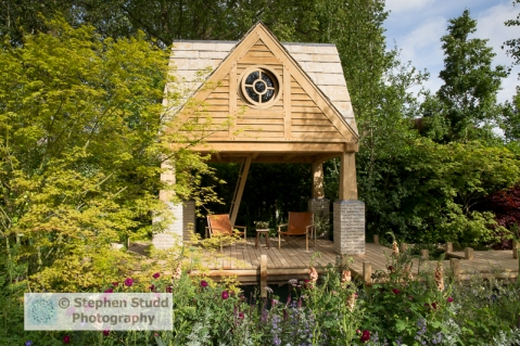 Stephen Studd - The M & G Garden The Retreat - oak summerhouse,, Rosa 'Tuscany Superb', Acer palmatum, Verbascum -designer Jo Thompson - sponsors M & G Investments awarded silver gilt medal
