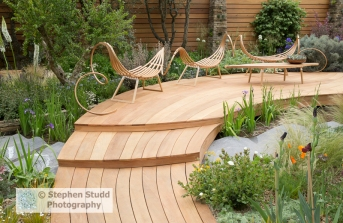Stephen Studd - Royal Bank of Canada Garden - laminated wood hammock style benches and a table on red cedar wood decking, cedar garden wall - Designer Matthew Wilson - Sponsor RBC - awarded Silver gilt