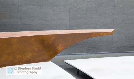 Photographer: Stephen Studd - The Chelsea Barracks Garden, view of bronze bench, Basaltite stone water wall - Designer: Jo Thompson - Sponsor: Qatari Diar